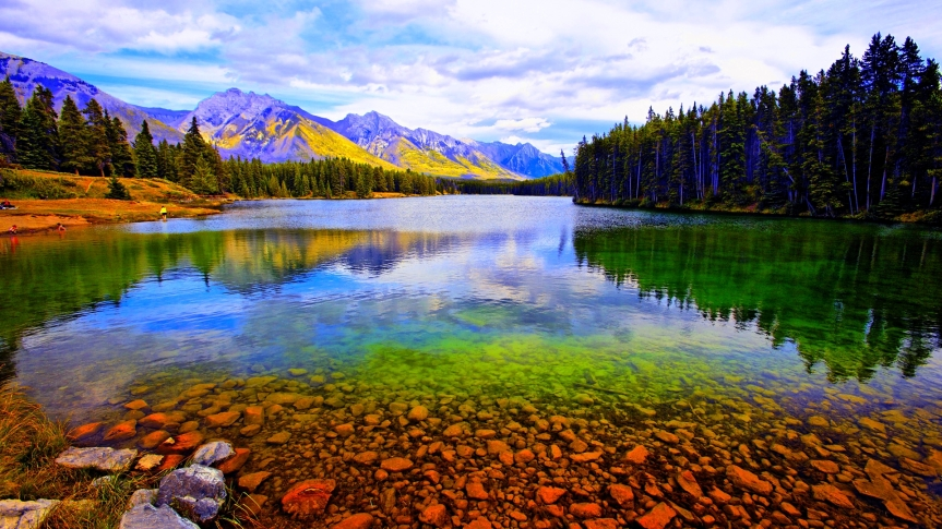 Reflection of mountains and trees in a lake, Lake Johnson, Banff National Park, Alberta, Canada